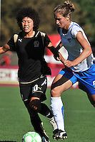 19 July 2009: Eriko Arakawa of the FC Gold Pride challenges Maggie Tomecka of the Boston Breakers during the game at Buck Shaw Stadium in Santa Clara, California.  The Boston Breakers defeated the FC Gold Pride, 1-0.