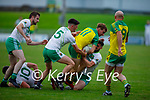 Gneeveguilla's Paul O'Leary runs in to a wall of Ballydonoghue defenders, Tommy Kennelly, Jack Gogarty anf Michael Foley in the 2020 County Junior Premier football final