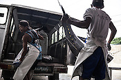 Workers offload and weigh the sustainably caught yellow fin tuna at the Casa, the Tuna buying house in Puerto Princesa, Palawan in the Philippines. <br /> Photo: Sanjit Das/Panos for Greenpeace