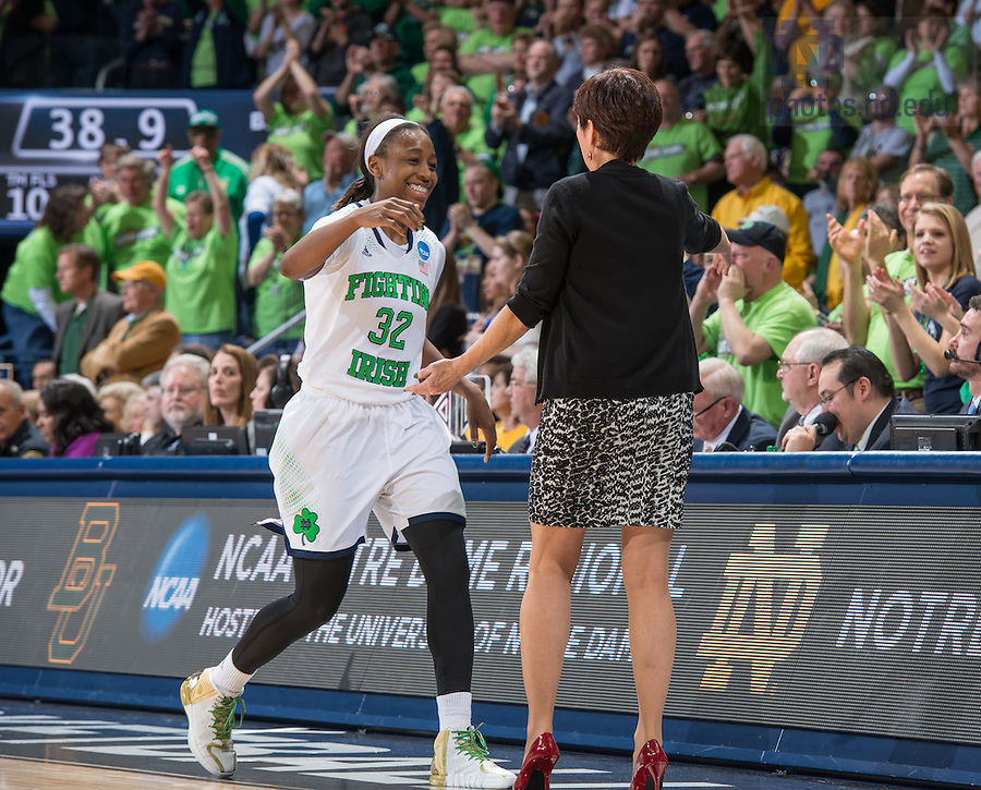 Mar 31, 2014; Jewel Loyd (32) hugs head coach Muffet McGraw as she leaves the game in the second half against the Baylor Bears in the regional final of the 2014 NCAA Tournament. Notre Dame won 88-69. <br /> <br /> Photo by Matt Cashore