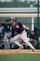 GCL Yankees East left fielder Raymundo Moreno (26) follows through on a swing during the second game of a doubleheader against the GCL Pirates on July 31, 2018 at Pirate City Complex in Bradenton, Florida.  GCL Pirates defeated GCL Yankees East 12-4.  (Mike Janes/Four Seam Images)
