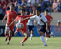 China's Xu Yunlong (13) battles USA's Charlie Davies (19) for the ball. The USA defeated China, 4-1, in an international friendly at Spartan Stadium, San Jose, CA on June 2, 2007.