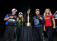 Nov 12, 2017; Pomona, CA, USA; (From left) NHRA funny car driver John Force , top fuel driver Brittany Force , funny car driver Robert Hight and funny car driver Courtney Force pose for a portrait as they celebrates after winning the 2017 top fuel world championship and the Auto Club Finals at Auto Club Raceway at Pomona. Mandatory Credit: Mark J. Rebilas-USA TODAY Sports
