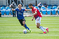 SAN JOSE, CA - APRIL 24: Jackson Yueill #14 of the San Jose Earthquakes chases Ryan Hollingshead #12 of FC Dallas during a game between FC Dallas and San Jose Earthquakes at PayPal Park on April 24, 2021 in San Jose, California.