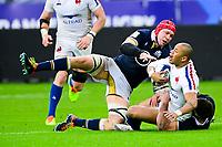 26th March 2021, Stade de France, Saint-Denis, France; Guinness 6-Nations international rugby, France versus Scotland;  Gael Fickou (Fra) stopped by Sam Skinner (Sco)