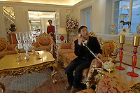 A buyer at the classic French inspired recepeption room in the Palais de Fortune luxury development in Beijing, China. The development consists of 172 luxury mansions selling for over 2 million pounds each. The development is a haven for China's super-rich terrified of kidnap and murder. The mansions are packed together and will form a dense community of millionaires..04 Jul 2008