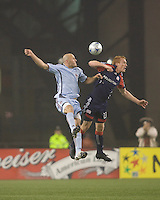 Colorado Rapids forward Conor Casey (9) and New England Revolution midfielder/defender Jeff Larentowicz (13) battle for a head ball. The New England Revolution tied the Colorado Rapids, 1-1, at Gillette Stadium on May 16, 2009.