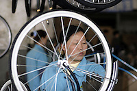 A worker installs components onto an almost finished bicycle at the Shanghai Forever Bicycle Factory (SFBF) in Shanghai, China. Despite the government's efforts to encourage automobile ownership in recent years, the bicycle remains the most popular mode of transportation for China's masses. The SFBF, it's products once a must have and a symbol of status for every Chinese family, are now supplying bicycles to countries around the world. It has seen it's sales increase 59% percent in the past year to 876 million yuan (euro 89.36 million)..21-APR-04