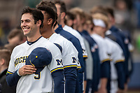 Michigan Wolverines first baseman Matthew Schmidt (9) during the national anthem before the NCAA baseball game against the Michigan State Spartans on May 7, 2019 at Ray Fisher Stadium in Ann Arbor, Michigan. Michigan defeated Michigan State 7-0. (Andrew Woolley/Four Seam Images)