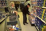 Senior couple 1990s UK supermarket shopping London buying weekly essential household goods. 90s England.