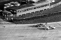 #6 Porsche 935 of Derek Bell, A.J. Foyt, and Bob Wollek, aerial view from Goodyear blimp, 3rd place,  and #83 Chevrolet Corvette of Karl Keck, Robert Whitaker, and William Wessel 40th place, 12 Hours of Sebring, IMSA Camel GT race, Sebring International Raceway, Sebring, Florida, March 24, 1984.  (Photo by Brian Cleary/www.bcpix.com)