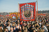 The NUM banner from Houghton Main colliery in South Yorkshire is carried by miners protesting in Hyde Park during the year long miners' strike against proposed pit closures by the government of Margaret Thatcher.