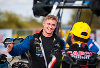 Oct 20, 2019; Ennis, TX, USA; NHRA top fuel driver Jordan Vandergriff (left) greets Billy Torrence during the Fall Nationals at the Texas Motorplex. Mandatory Credit: Mark J. Rebilas-USA TODAY Sports