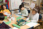Education Elementary school Grade 2 students working independently at table