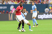 Houston, TX - Thursday July 20, 2017: Gabriel Jesus and Paul Pogba during a match between Manchester United and Manchester City in the 2017 International Champions Cup at NRG Stadium.