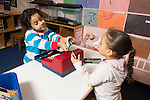 Preschool 4 year olds boy and girl playing store