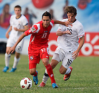 Bryan Santamaria (17) of Panama tries to fight off Andrew Oliver (16) of the United States during the group stage of the CONCACAF Men's Under 17 Championship at Jarrett Park in Montego Bay, Jamaica. The USA defeated Panama, 1-0.