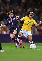August 03, 2012 - Japan's Nahomi Kawasumi and Brazil's Fabiana fight for possession during Group F match between JPN and BRA at the Millennium Stadium. .