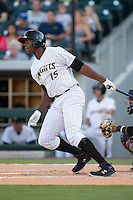 John Mayberry Jr. (15) of the Charlotte Knights follows through on his swing against the Rochester Red Wings at BB&T BallPark on August 8, 2015 in Charlotte, North Carolina.  The Red Wings defeated the Knights 3-0.  (Brian Westerholt/Four Seam Images)