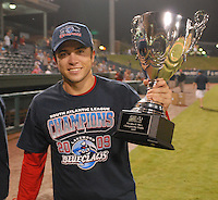 Sept. 18, 2009: Catcher Travis d'Arnaud of the Lakewood BlueClaws holds the trophy after winning Game 4 of the South Atlantic League Championship Series against the Greenville Drive 5-1 at Fluor Field at the West End in Greenville, S.C. Lakewood won the series 3 games to 1. Photo by: Tom Priddy/MiLB.com