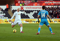 SWANSEA, WALES - FEBRUARY 07: L-R Jonjo Shelvey of Swansea against Jordi Gomez of Sunderland during the Premier League match between Swansea City and Sunderland AFC at Liberty Stadium on February 7, 2015 in Swansea, Wales.