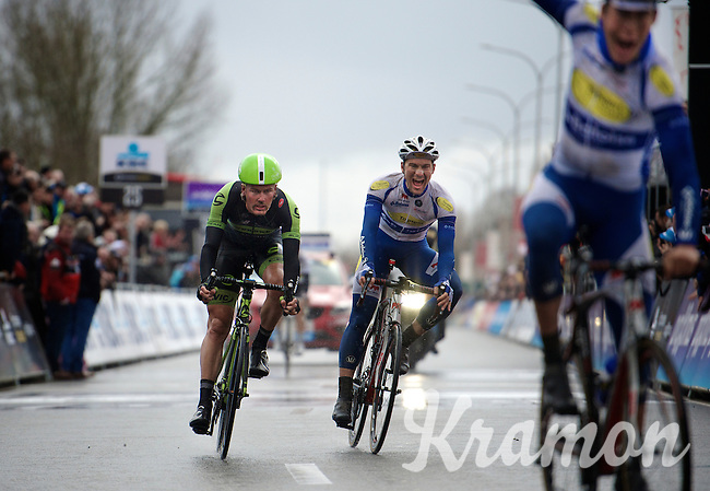 Edward Theuns (BEL/TopsportVlaanderen-Baloise) makes 2nd over the finish line while cheering for his teammate/winner<br /> Jelle Wallays (BEL/Topsport Vlaanderen-Baloise).<br /> Dylan van Baarle (NLD/Cannondale-Garmin) finishes 3rd.<br /> <br /> <br /> 70th Dwars Door Vlaanderen (2015) while teammate