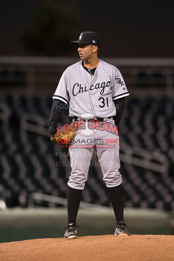 AZL White Sox relief pitcher Rigo Fernandez (31) looks to his catcher for the sign during an Arizona League game against the AZL Indians 1 at Goodyear Ballpark on June 20, 2018 in Goodyear, Arizona. AZL Indians 1 defeated AZL White Sox 8-7. (Zachary Lucy/Four Seam Images)