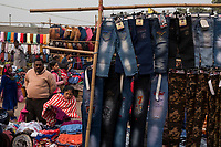 People look at clothing for sale in the street market on Meena Bazar in the Chadni Chowk area of Delhi, India, on Tue., Dec. 11, 2018.