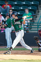 Brandon Bednar (19) of the Augusta GreenJackets follows through on his swing against the Hickory Crawdads at L.P. Frans Stadium on May 11, 2014 in Hickory, North Carolina.  The GreenJackets defeated the Crawdads 9-4.  (Brian Westerholt/Four Seam Images)