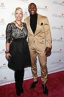 HOLLYWOOD, LOS ANGELES, CA, USA - OCTOBER 09: Rebecca King-Crews, Terry Crews arrives at the Eva Longoria Foundation Dinner held at Beso Restaurant on October 9, 2014 in Hollywood, Los Angeles, California, United States. (Photo by David Acosta/Celebrity Monitor)