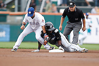 Syracuse Chiefs outfielder Roger Bernadina #16 slides into second base safely as Luis Hernandez #1 applies the tag with umpire Karl Best looking on during the first inning of a game against the Buffalo Bisons at Coca-Cola Field on September 1, 2011 in Buffalo, New York.  Bernadina doubled off Bisons starting pitcher Dylan Owen forcing Owen to leave the game due to injury.  Syracuse defeated Buffalo 6-2.  (Mike Janes/Four Seam Images)