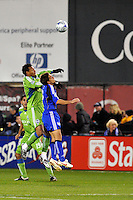 Tyrone Marshall (green), Josh Wolff...Kansas City Wizards were defeated 3-2 by Seattle Sounders at Community America Ballpark, Kansas City, Kansas.