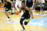 CHAPEL HILL, NC - FEBRUARY 24: Koby McEwen #25 of Marquette brings the ball up the court during a game between Marquette and North Carolina at Dean E. Smith Center on February 24, 2021 in Chapel Hill, North Carolina.