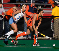 Marta Malmberg (24) of UNC stays close to Tara Puffenberger (1) of Virginia during the NCAA Field Hockey Championship semfinals in College Park, MD.  North Carolina defeated Virginia, 4-3, in overtime.