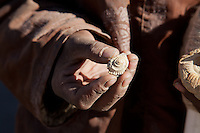 A Tibetan villager diplays a fossil seashell found high on the Tibetan plateau