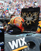 Jun. 17, 2011; Bristol, TN, USA: NHRA funny car driver Tony Pedregon climbs from his escape hatch during qualifying for the Thunder Valley Nationals at Bristol Dragway. Mandatory Credit: Mark J. Rebilas-