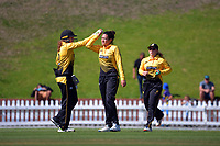 Jess McFadyen congratulates Thamsyn Newton on a wicket during the Hallyburton Johnstone Shield women's cricket match between Wellington Blaze and Otago Sparks at the Basin Reserve in Wellington, New Zealand on Sunday, 14 March 2021. Photo: Dave Lintott / lintottphoto.co.nz