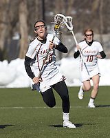 Boston College midfielder Kate McCarthy (20) brings the ball forward. .Boston College (white) defeated Boston University (red), 12-9, on the Newton Campus Lacrosse Field at Boston College, on March 20, 2013.