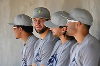 Harol Gonzalez (45), left, Tim Tebow (15), Gene Cone (9) and Desmond Lindsay (2) of the Columbia Fireflies wait in the dugout before a game against the Lexington Legends on Saturday, April 22, 2017, at Spirit Communications Park in Columbia, South Carolina. Lexington won, 4-0. (Tom Priddy/Four Seam Images)
