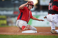 Williamsport Crosscutters catcher Henri Lartigue (40) slides into third base during a game against the Batavia Muckdogs on September 2, 2016 at Dwyer Stadium in Batavia, New York.  Williamsport defeated Batavia 9-1. (Mike Janes/Four Seam Images)