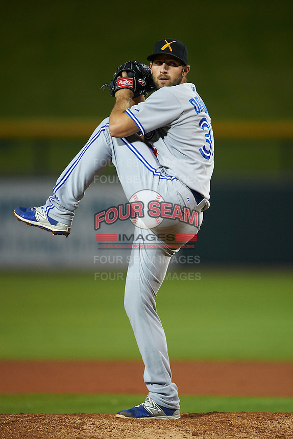Salt River Rafters pitcher Brady Dragmire (33) delivers a pitch during an Arizona Fall League game against the Mesa Solar Sox on October 23, 2015 at Sloan Park in Mesa, Arizona.  Salt River defeated Mesa 5-1.  (Mike Janes/Four Seam Images)