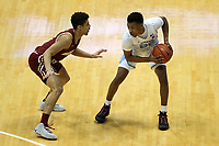 CHAPEL HILL, NC - FEBRUARY 1: Christian Keeling #55 of the University of North Carolina is guarded by Derryck Thornton #11 of Boston College during a game between Boston College and North Carolina at Dean E. Smith Center on February 1, 2020 in Chapel Hill, North Carolina.