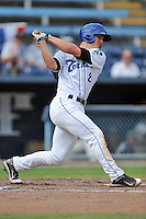 Asheville Tourists first baseman Derek Jones #8 swings at a pitch during game one of a double header against the Greensboro Grasshoppers on July 2, 2013 in Asheville, North Carolina.  The Tourists won the game 5-3. (Tony Farlow/Four Seam Images)