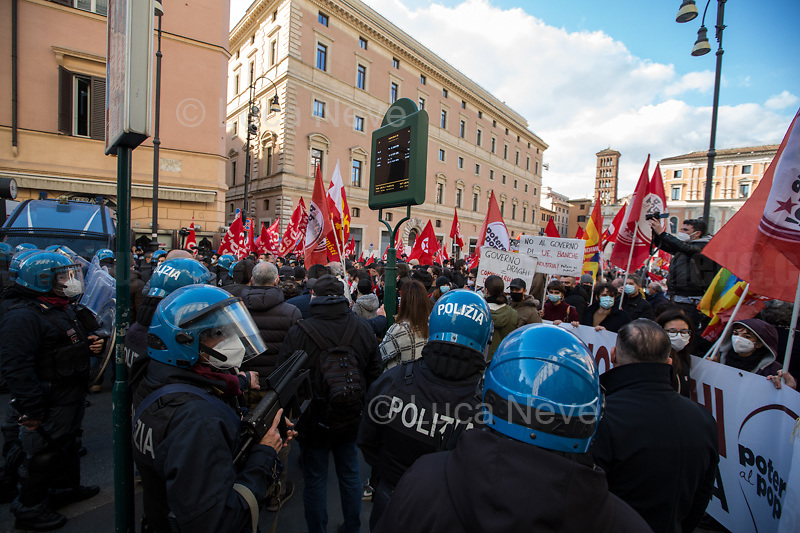 Teargas launcher. <br /> <br /> Rome, Italy. 18th Feb 2021. Today, the Trade Union Si Cobas, Potere Al Popolo Party, Rifondazione Comunista Party and other organizations of the non-parliamentarian Left held a rally (1.) in Piazza San Silvestro to protest against the new Italian Government led by the former President of the European Central Bank, BCE, Professor Mario Draghi (2. 3.). From the organisers Facebook event page: «[…] We call to mobilize male and female workers, the unemployed, the precarious, the students, the popular classes and all the associations and people who struggle, who do not want to stand by while a government that is directed expression of a united bosses front is ready to strike us with anti-people policies. It is time to join the fight against the government of banks and bosses: we will not pay for this crisis! […]». The demo ended peacefully, even though there were moments of tension between protesters and full riot gears police officers due to demonstrators aimed to march to the Parliament.<br /> <br /> Footnotes & Links:<br /> 1. https://www.facebook.com/events/4966336456769715<br /> 2. 13.02.2021 - Mario Draghi's New Italian Government Swears At Quirinale Palace http://bit.do/fNPQ5<br /> 3. 17.02.2021 - Italian Prime Minister Mario Draghi Arrives at Italian Senate http://bit.do/fNPRc