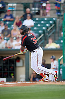 Rochester Red Wings designated hitter Kennys Vargas (30) follows through on a swing during a game against the Lehigh Valley IronPigs on September 1, 2018 at Frontier Field in Rochester, New York.  Lehigh Valley defeated Rochester 2-1.  (Mike Janes/Four Seam Images)