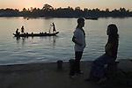 Pathein. ( Bassein ) Looking across the Ayeyarwady ( Irrawaddy) river at dusk. Myanmar Burma 2011.