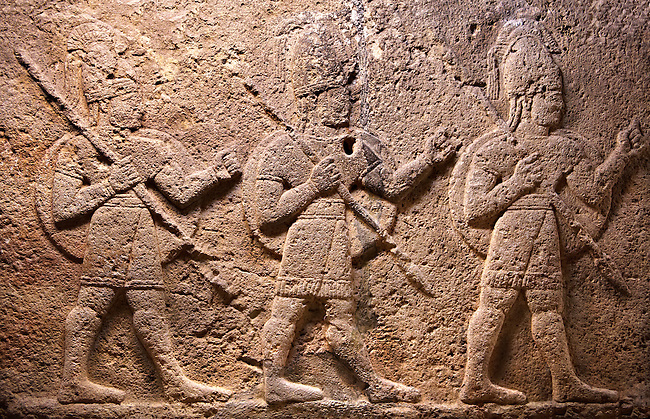 Image of Neo-Hittite orthostat with releif sculpture of 3 soldiers from the legend of Gilgamesh from Karkamis,, Turkey. Museum of Anatolian Civilisations, Ankara.