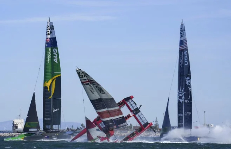 At the first turning mark, the Brits followed the same fate as the Spanish and capsized the boat following a serious nose-dive. The spectacular capsize inevitably ended the Brits quest for the top spot, leaving the Aussies to run away with the win. See vid below