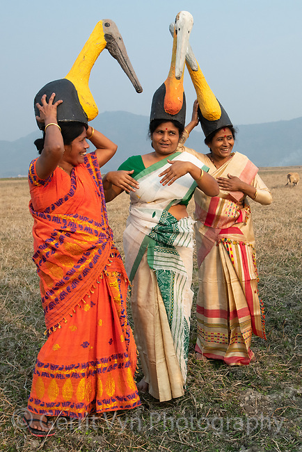 Conservation leader Prunima Devi Barman and members of the Hargilla Army conservation group pose for selfies while practicing song and dance for an adjutant celebration. Dadara, Assam, India. February.