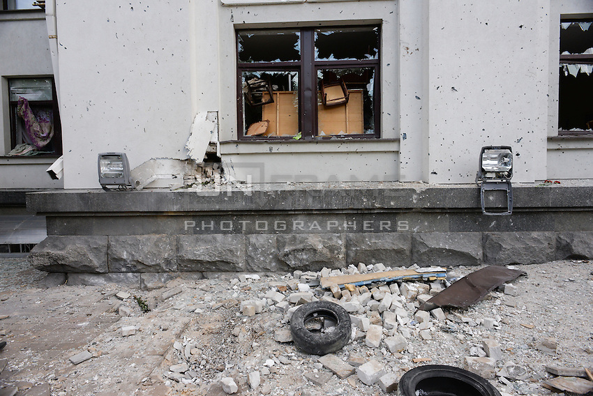 The facade of Lugansk town hall after the Ukraine army airstrike that killed 8. Kiev has admitted showering Lugansk with dozens of missiles from the air.
